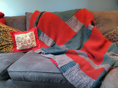 Red and Blue Sweater Blanket on couch