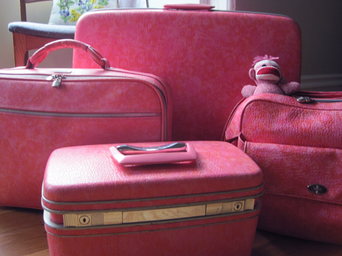 pink and orange vintage samsonite suitcase set
