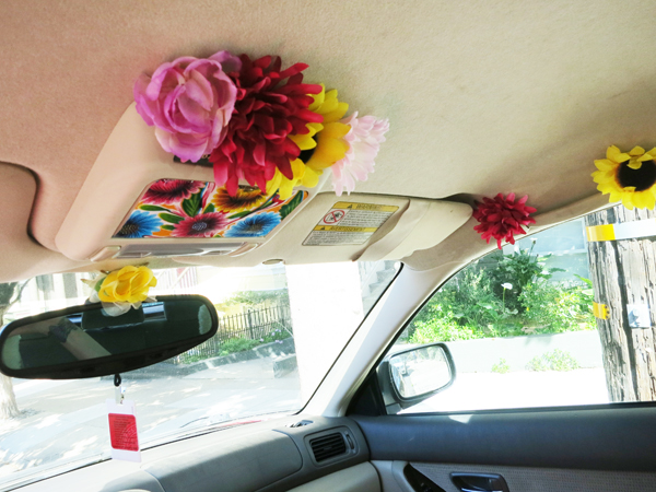fake flowers glued to car