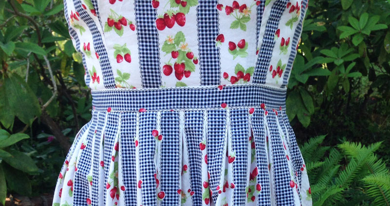 gingham and strawberry waistband and pleats
